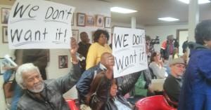 Protestor at the meeting.