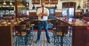 Craig Bayens, who has work in several area restaurants, shown here at Artesano Vino Tapas Y Mas in St. Matthews.