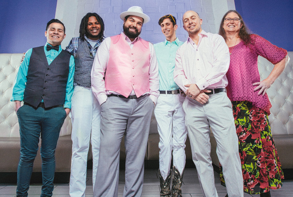 Leo Lopez, Darren Jordan, Nicholas Moore, Josh Bowling, Micah McGowan and Rachel Lighter, community members who have all participated in LGBTQ+ Community Coalition town hall meetings and Rainbows & Roses planning. Photo by Antonio Pantoja.