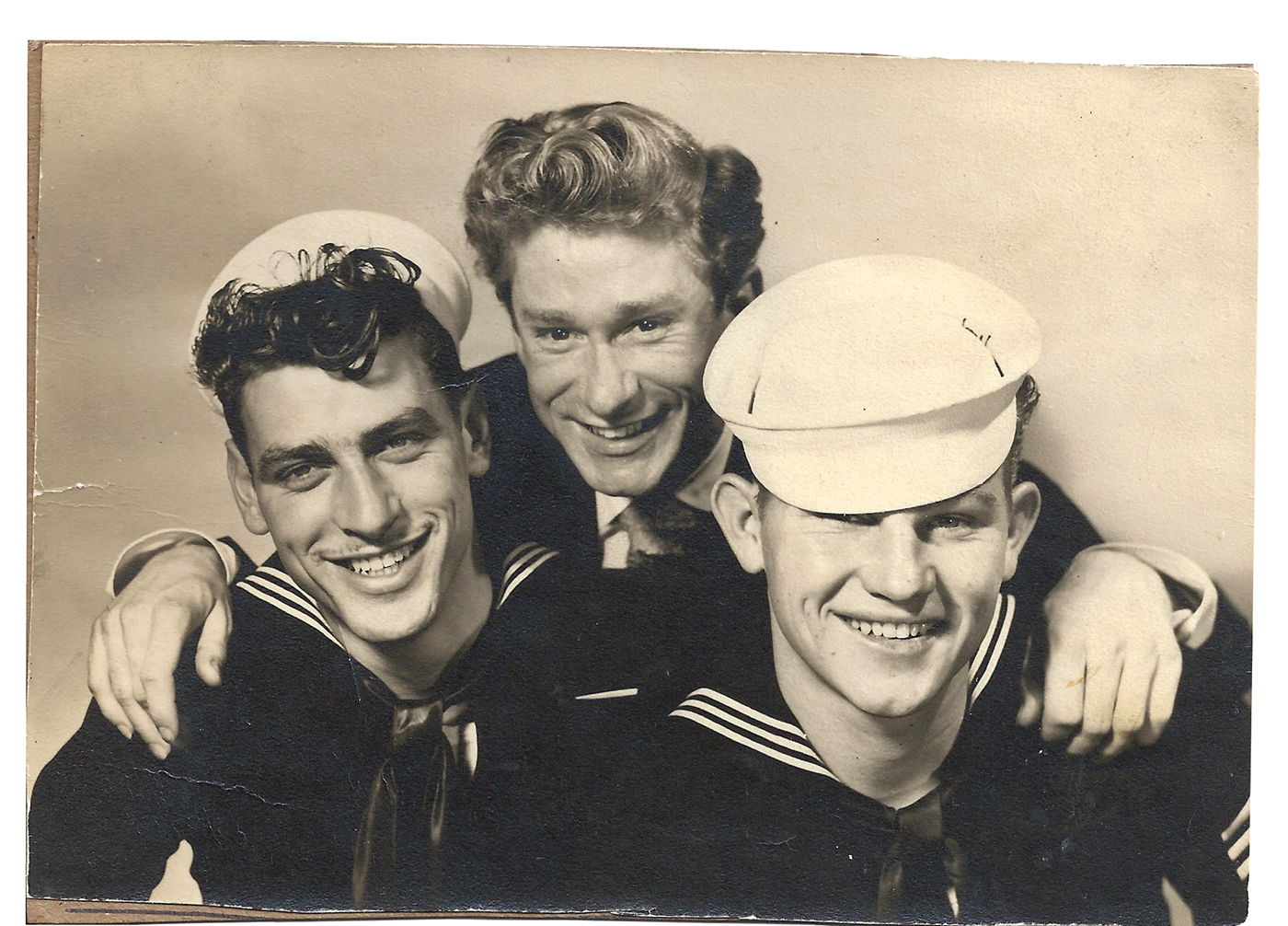 Henry Faulkner with two soldiers c. 1940s. Image courtesy of the Faulkner-Morgan Pagan Babies Archive.