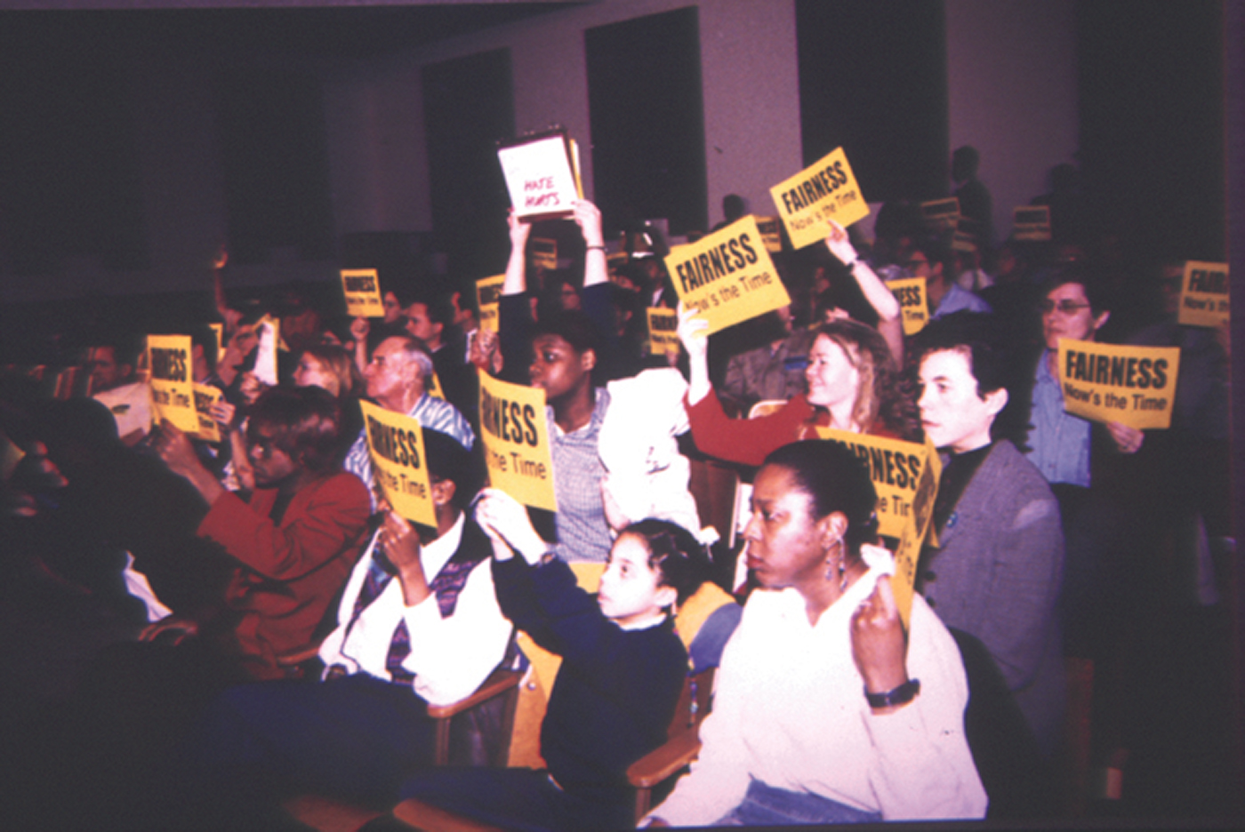 On January 12, 1999, supporters gathered in Louisville's City Hall to witness the reintroduction of the Fairness Ordinance before the Board of Aldermen. The ordinance passed that night after more than seven years of organizing. Fairness Co-Founders Carla Wallace and Pam McMichael are at the far right. Photo courtesy of the Fairness Campaign.