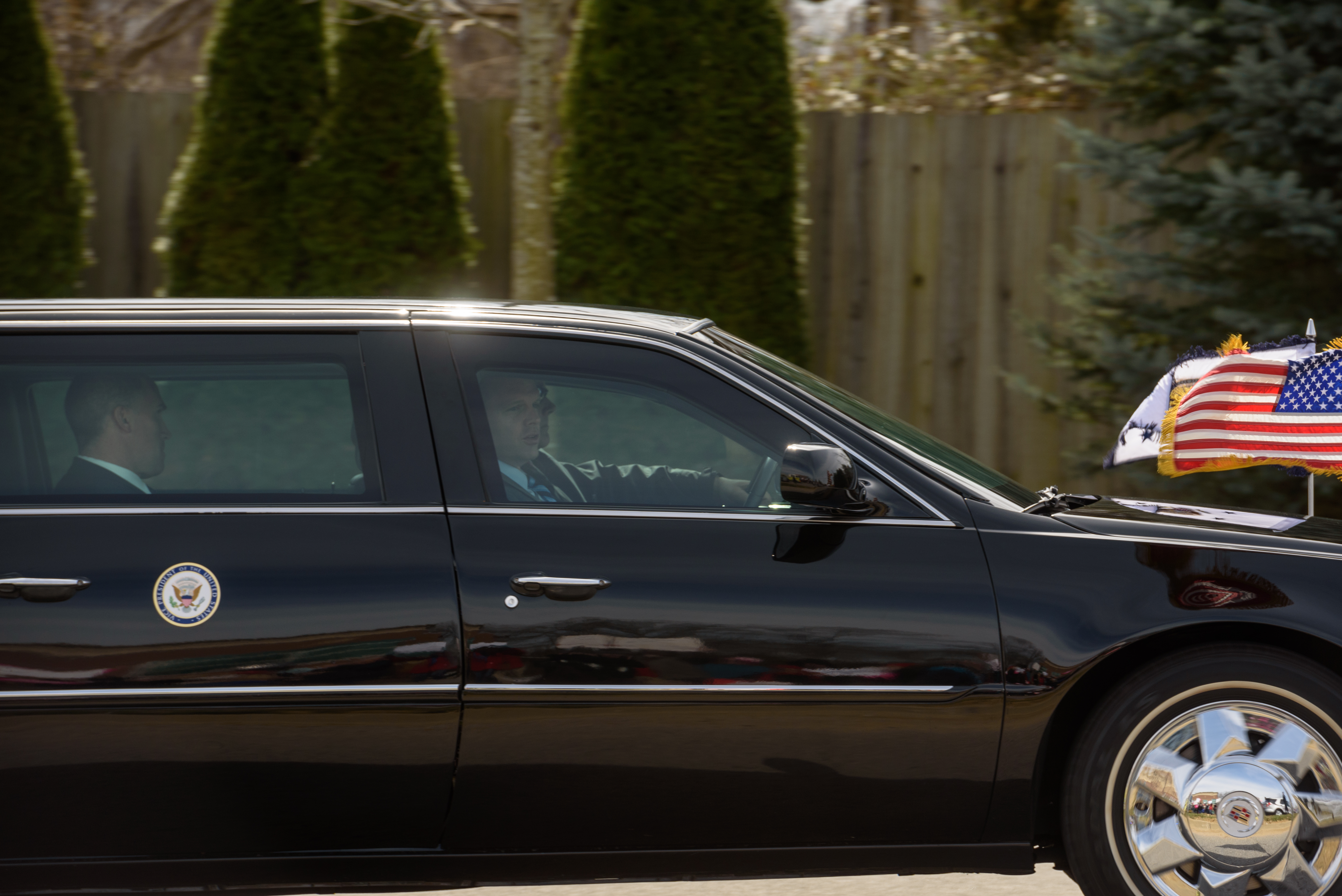 The Vice Presidential limousine passes by protesters on it's way to the airport.